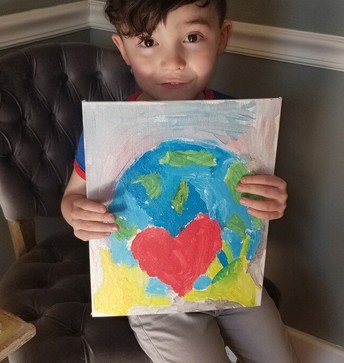 Student with Earth Day Artwork