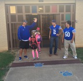 Varsity Players and Coaches welcome Int Kids to School
