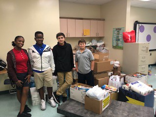 Students Dropping Off Donations