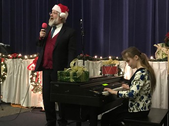 State Superintendent DeMaria sings with Perseus
