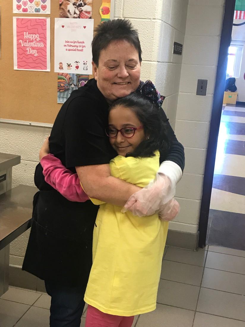 Mrs. Martinez hugging a student