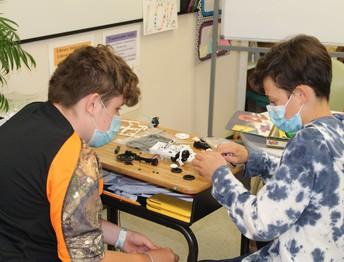 Investigating Ohm's Law by Building Solar Vehicles
