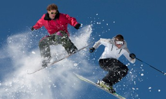 Two people one on skis and one on a snowboard