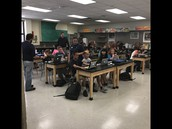 Apple employees assisted LMS students with MacBook deployment.