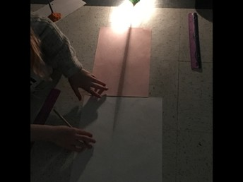 4P experimenting with shadow sticks.