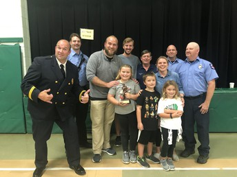 Addison Roberts won a ride to school in the fire truck.