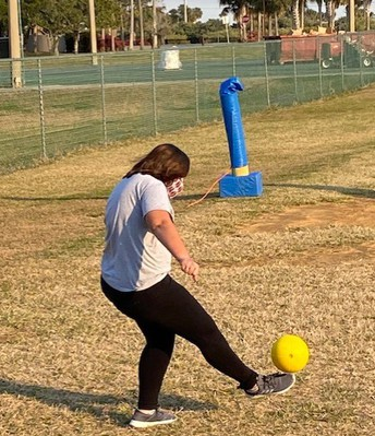 A student's foot meets the ball in the air