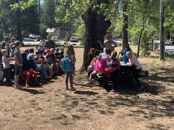 3rd graders learning from ranger friends