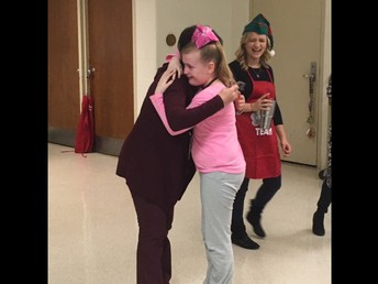 Retirement hugs for Ms. Riccinto