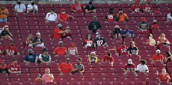 photo of people sitting in stadium stands