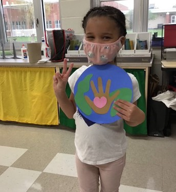 Student holding Earth Day project