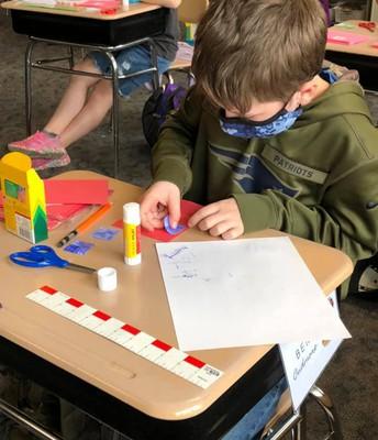 Ben making fraction cards