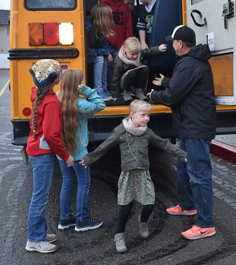 Students practice bus evacuation