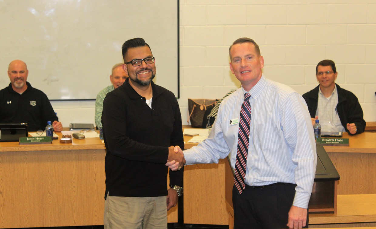 Mr. Aleman and Mr. Cagle shaking hands