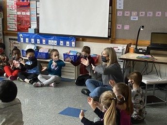 Mrs. Frostman providing a non-singing music activity.