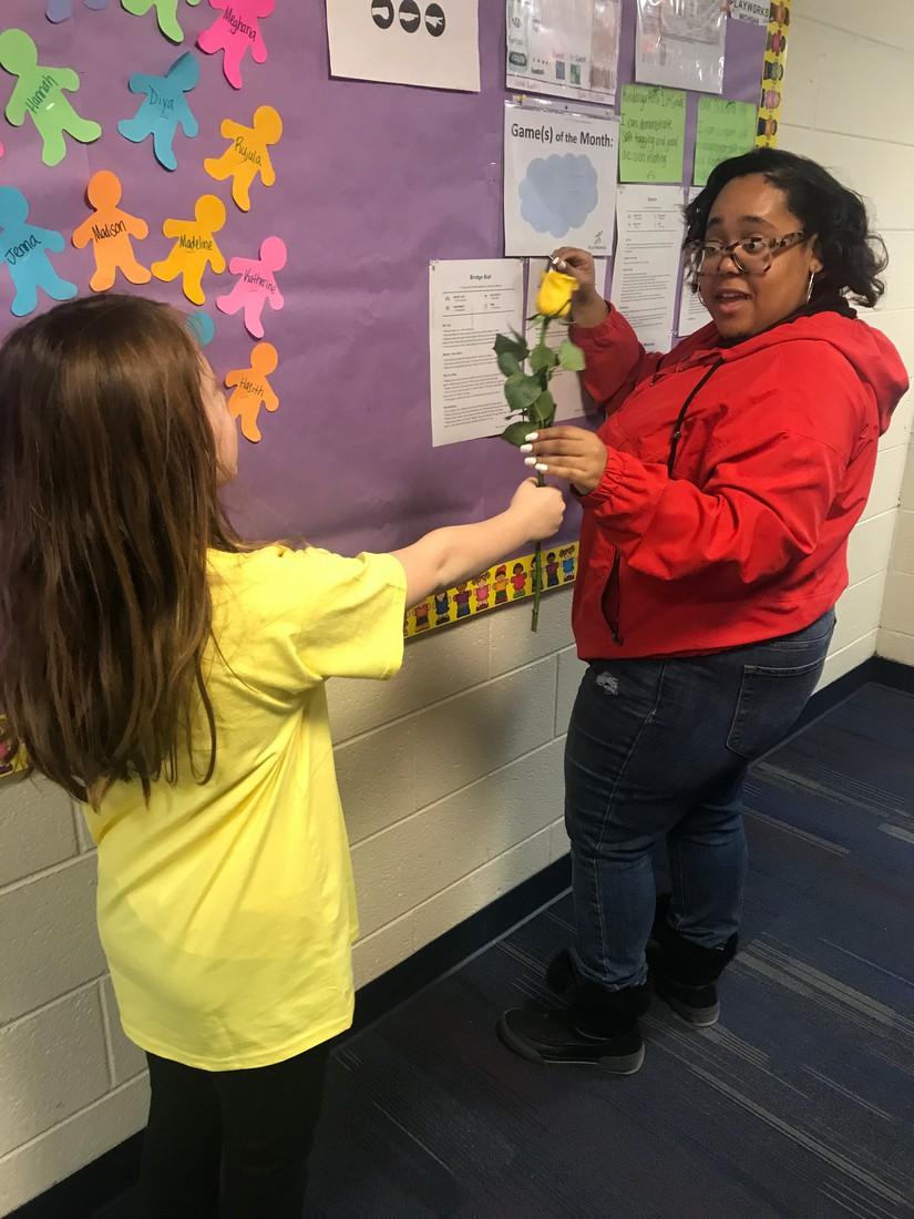 Coach P receiving a flower