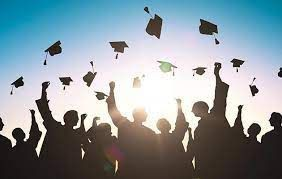 Image of grads throwing their hats.