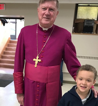 Bishop McManus and Aiden join Fr. Carlos on his special day.