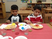 Domenik and Markell decorate cookies.