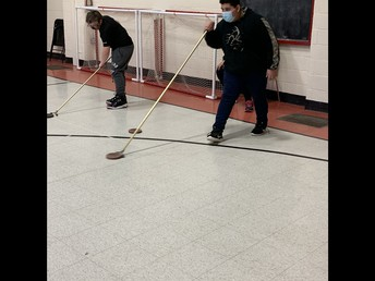 CVS: practicing addition and subtraction of integers through a game of shuffleboard