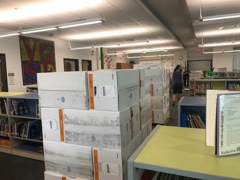 Here are some of the many pallets of books that arrived in August thanks to a library grant!