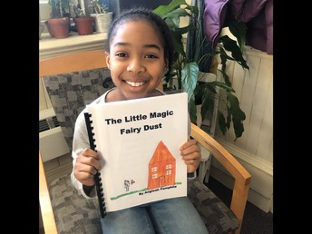 A 3rd Grade Author Proudly Shows Her 1st Chapter Book