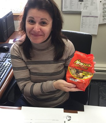 Dr. Gifford fills Nellie's candy jar.