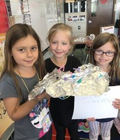 Victoria, Olivia, and Ellie made a unicorn on an island.