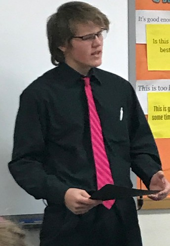 Isaiah giving his speech to a parent group