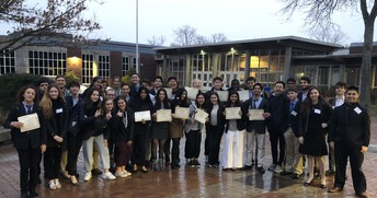GHS Model UN Club poses with their certificates that they won at the Harvard Model United Nations Conference