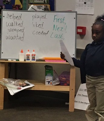 1st grade student sharing her writing