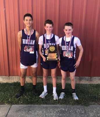 L to R:  4th place, 1st place and 2nd place at the District Meet.