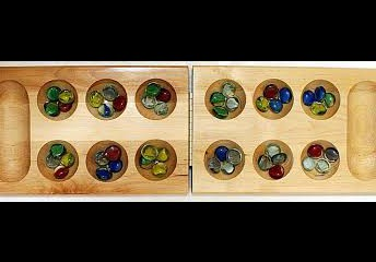 Modern Mancala Board - this game has been played for centuries all over the world - including in Ethiopia!