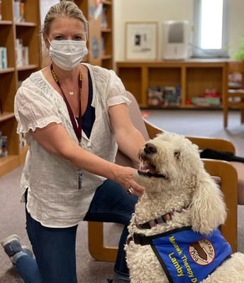 Madame Trombly and therapy pup, Lamby