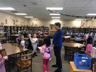 Mrs. Sheridan was helping students shop for books!