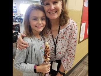September 23 marks the official beginning of autumn...but Indian corn means were awfully close!   This is a photo of Mrs. Frasure and Kadence Brockett with the first ear of Indian corn picked this year from last year's third grade pioneer garden planted in May!