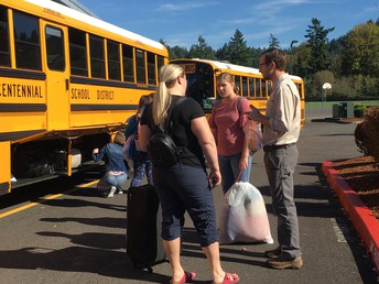 Mr. Bihler meeting parents and students at departure time.