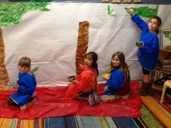 Painting the rainforest mural.