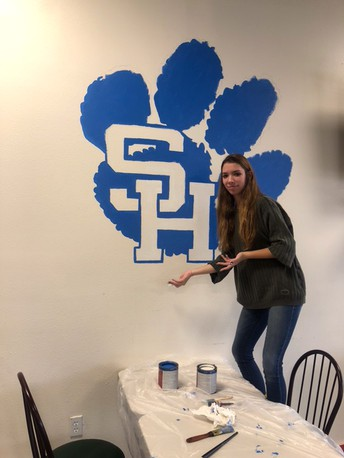 High School Art Students Paint Panther Logo for New Restaurant
