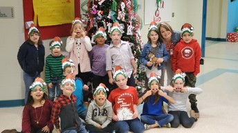 1st grade goofed around with Mrs. Brashear after reading How the Grinch Stole Christmas!