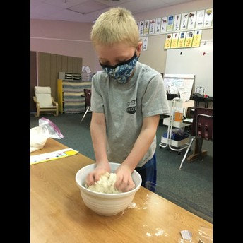 We love hands on activities like reading recipes to make play dough.
