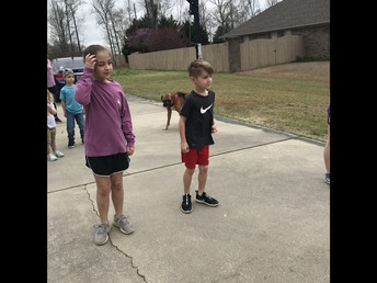 Blake and Cooper are dancing in the driveway.