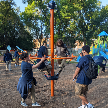 Students play on playground equipment.
