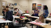 The HHS French Club painted signs for the upcoming Spring Fest.