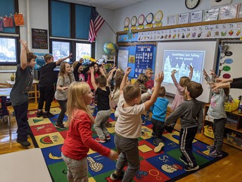 Park Elementary Kindergarten students incorporate movement into a song about snow while in music class with Mrs. Sharon Monarchino.