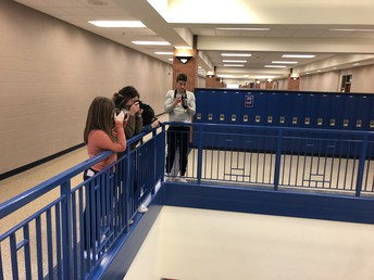 Students from Photography practice new skills around UHS