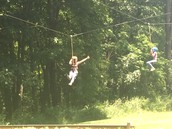 Zip-Lining at Camp with a student
