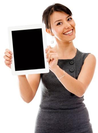 Teacher smiling holding tablet