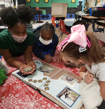 Mrs. Venturi's class has been studying rocks & volcanos.  Here they investigate a rock from the 79 AD eruption of Mt. Vesuvius.