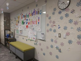 The kids decked out Mr. Gualtieri's office with snowflakes of congratulations